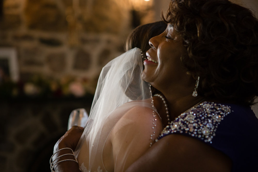 Bride hugging guest at wedding