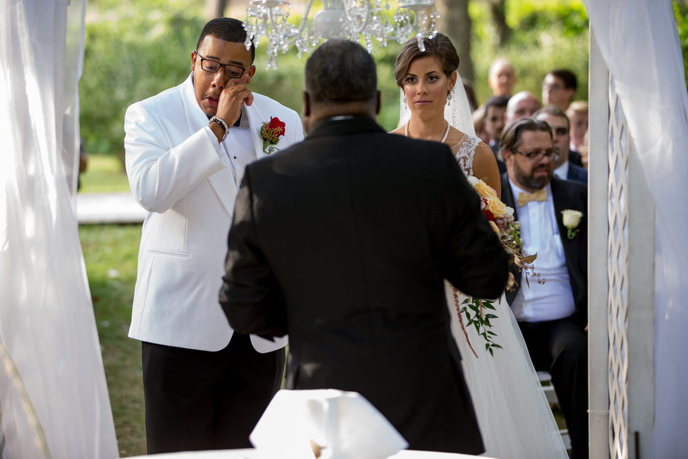 Photo of bride and teary groom during wedding ceremony