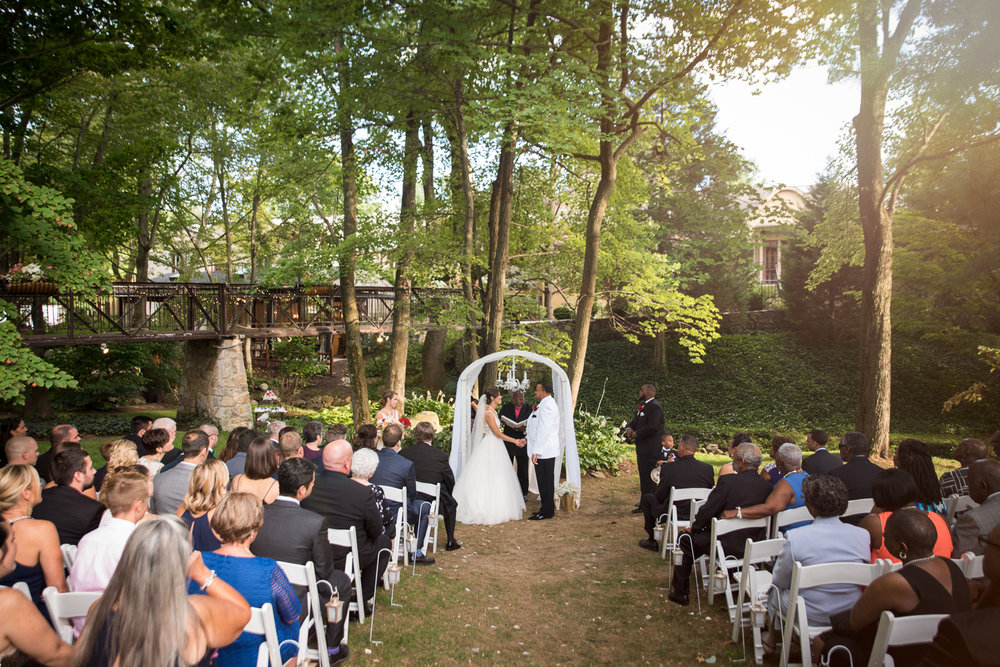 Photo of outdoor wedding ceremony at The Pomme in Radnor, PA