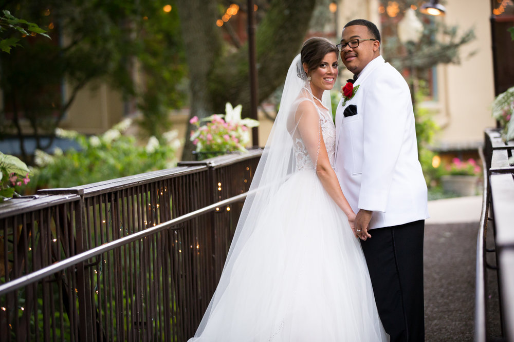 Photo of bride and groom on the bridge at The Pomme in Radnor