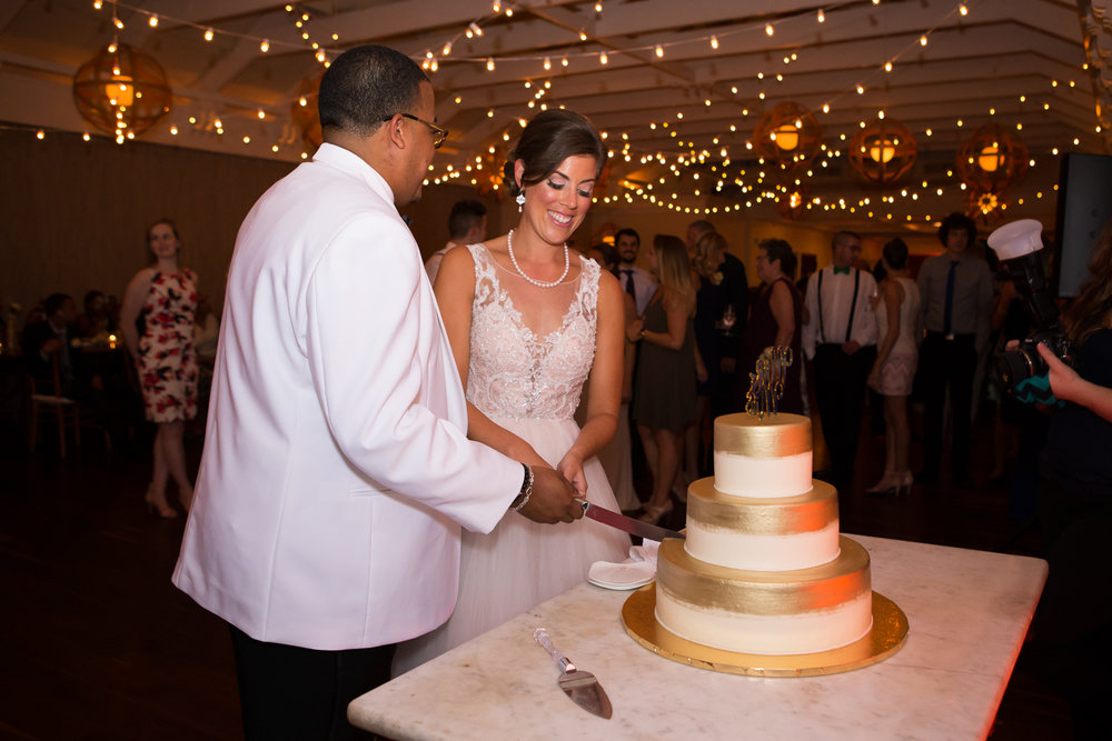 Photo of bride and groom cutting their wedding cake