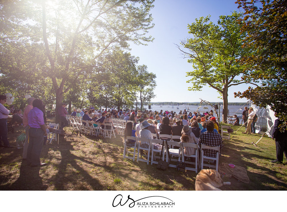Photo of outdoor wedding reception on the bay with a blue sky