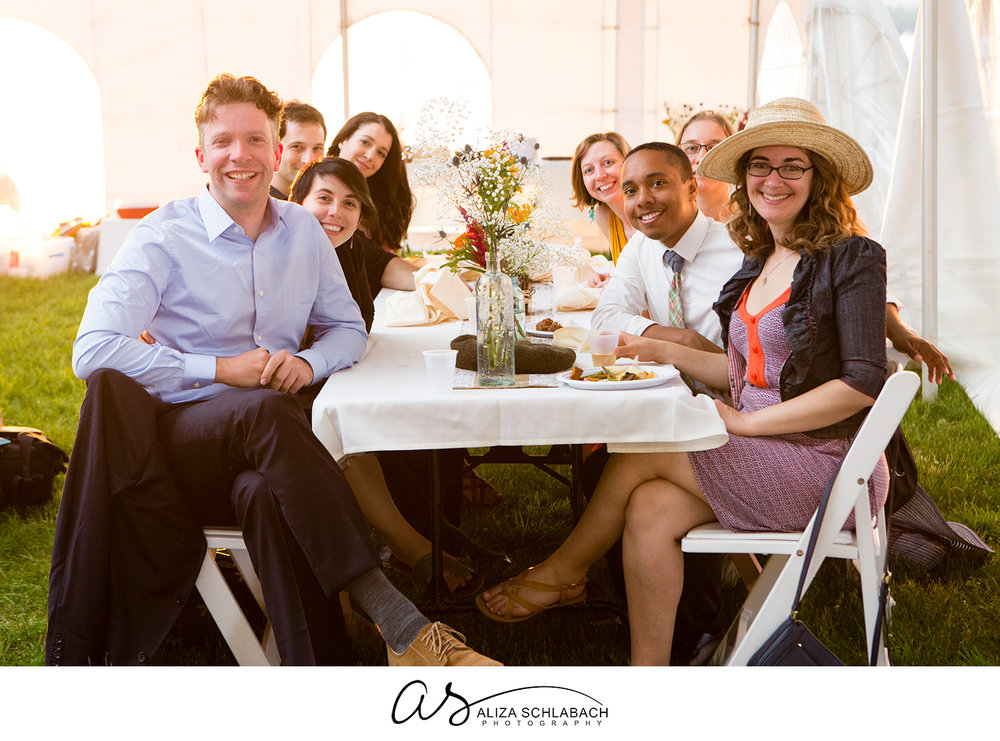 Photograph of a table of wedding guests in a tent