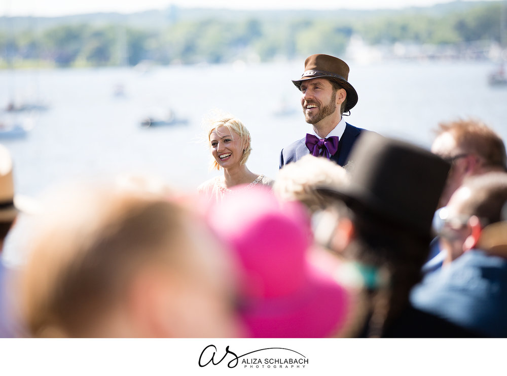 Photo of bride and groom during their wedding over the crowd