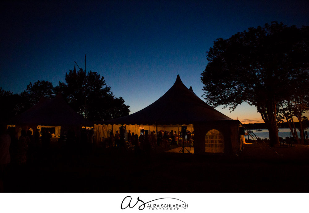 Photo at dusk of the wedding tents lit up