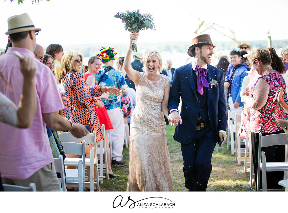 Photo of a bride and groom walking down the isle after their ceremony