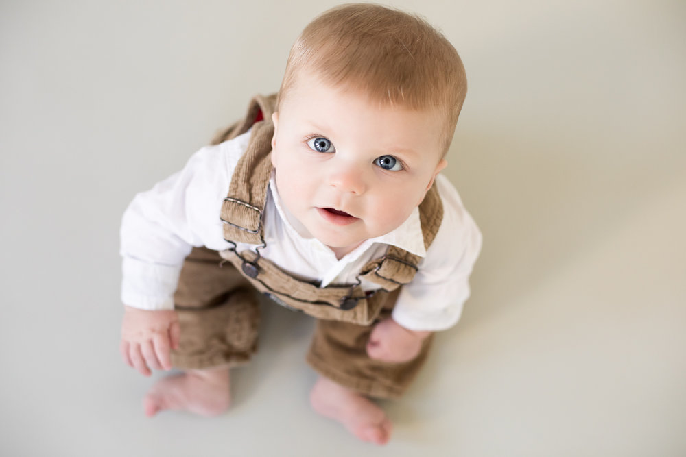 Baby boy portrait, looking up into camera