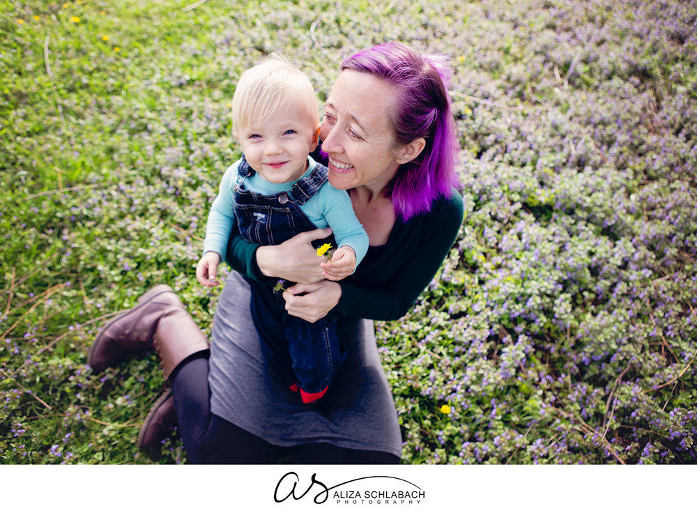 Photo from above of a woman with dyed purple hair and her little boy