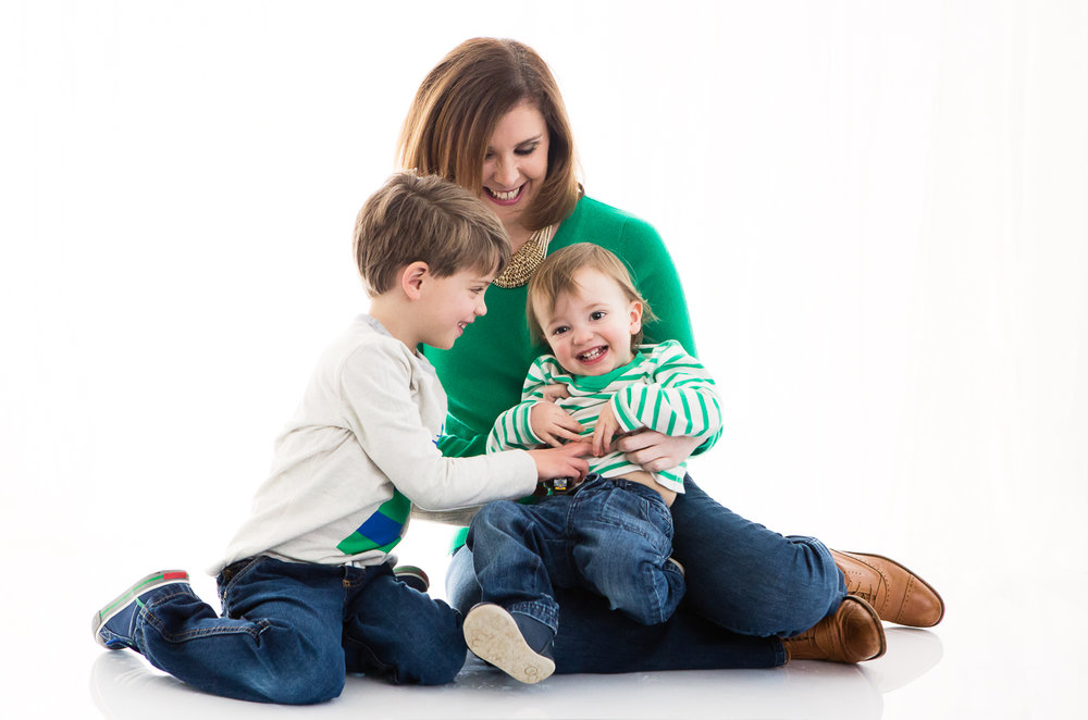 Backlit studio photo of an Aunt with her 2 young nephews