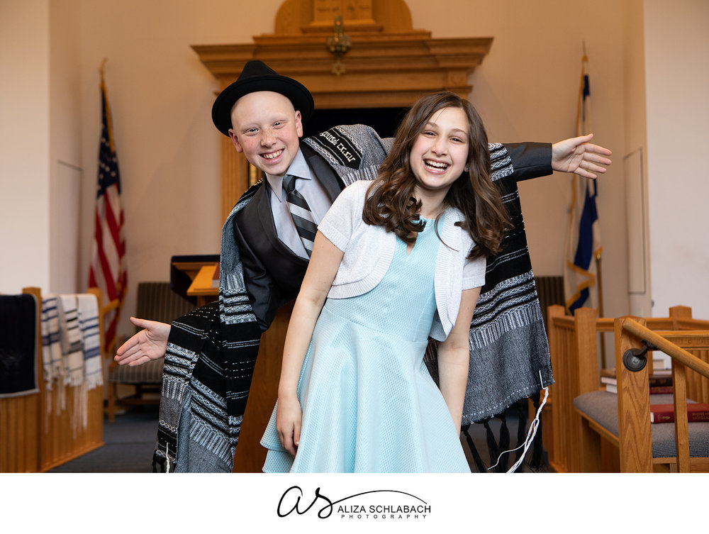 Cute photograph of Bar Mitzvah boy and his little sister