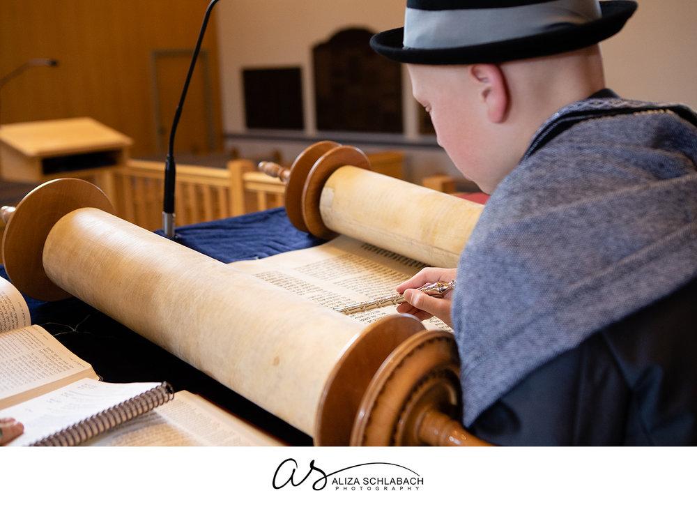 Photo of Bar Mitzvah boy reading from Torah