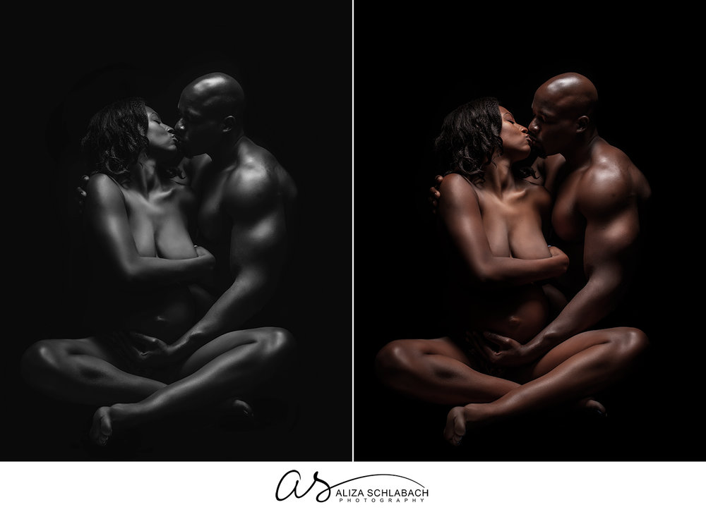 Dramatically lit maternity portrait of a nude black couple