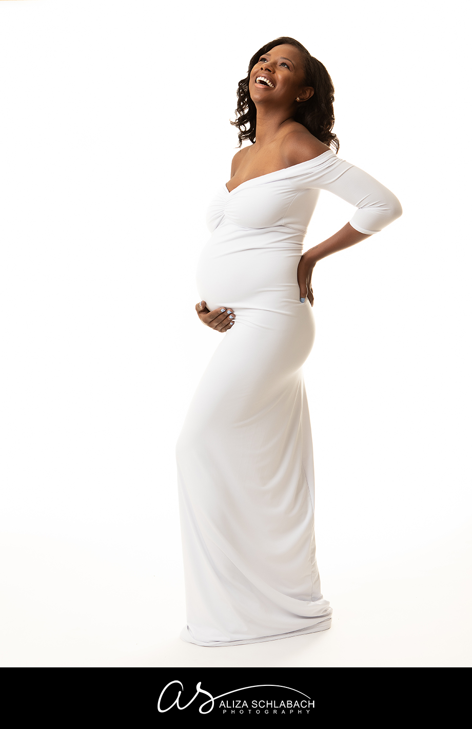 Stunning black pregnant woman in white gown