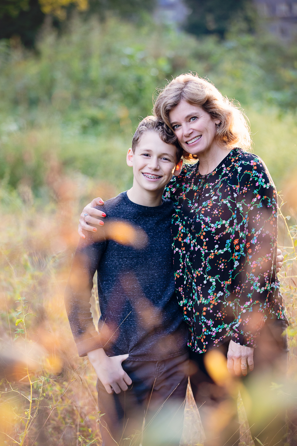 Photo of a mom and her preteen son in a field
