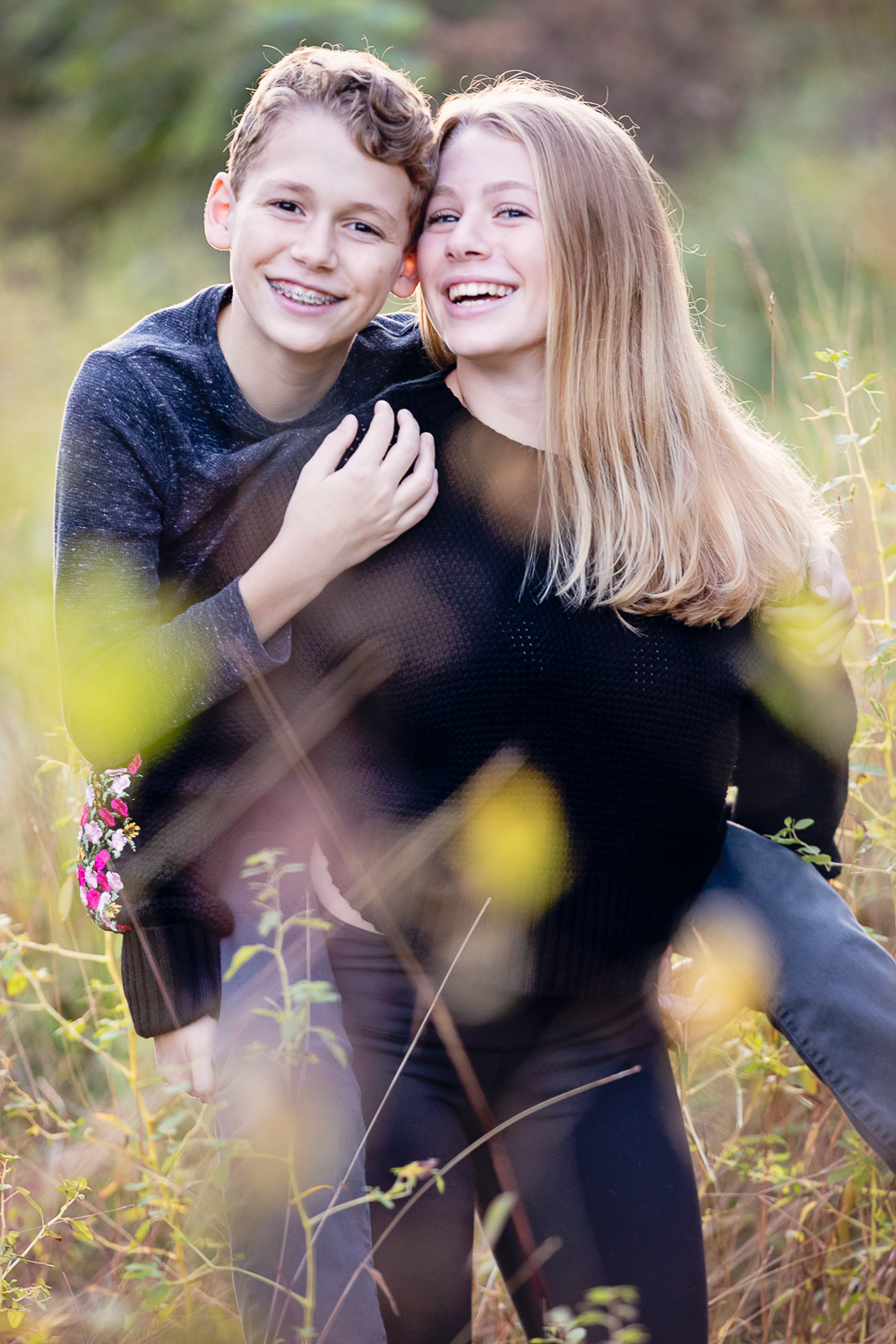 Fall photos of a teenage girl and her brother at Haverford College -- piggy back ride