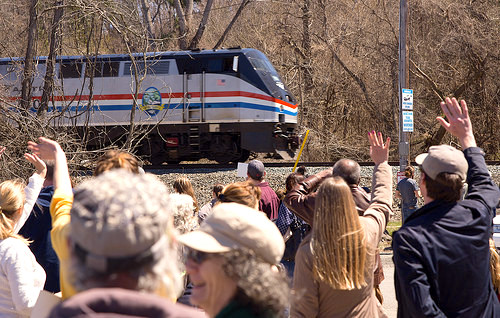 Attendees at the Germantown rally to fight the fences on April 22 wave to a passing Amtrak train. Photo by Kaare Christian.