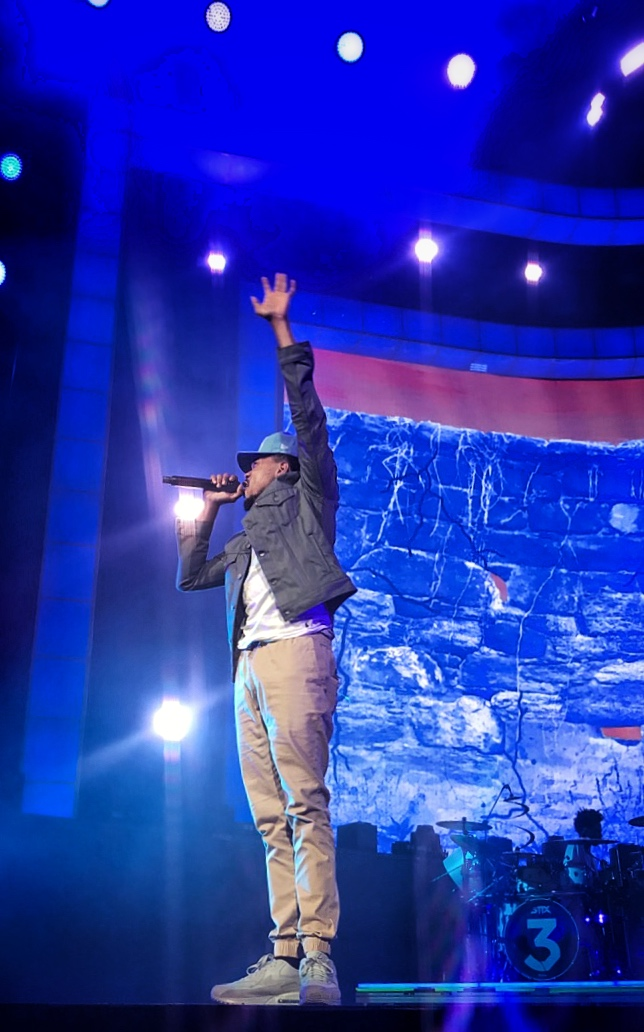 """When the praises go up the blessings come down"", raps Chance the Rapper while performing his hit singe ""Blessings"" on the  Be Encouraged Tour  in Sacramento, California."