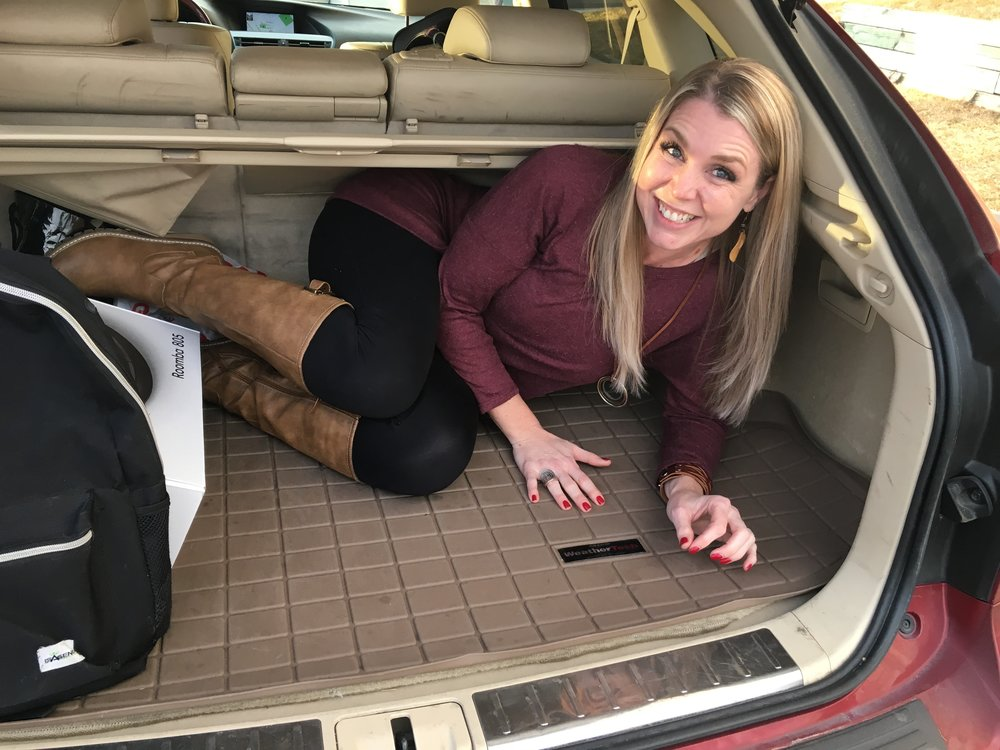 Yes, that is me hiding in the trunk.  Kim knew I was coming and asked Melissa to help her grab her bags.  To say we shocked her, might be the understatement of the year.  Watch the videos below to see the excitement in real time. ;)