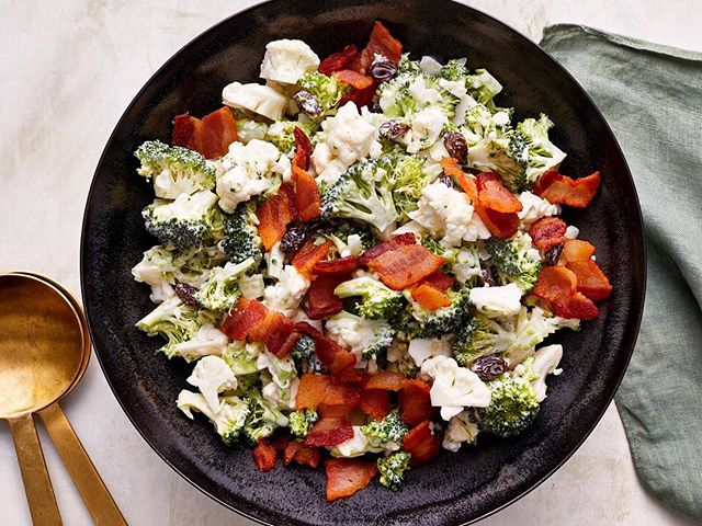 #Repost @cookinglight ・・・ This is not your grandma's broccoli salad! Sure, we kept the bacon and the raisins (and added cauli!), but tart apple cider vinegar and Greek yogurt are a tastier stand-in for traditional mayo. Tap the link in our profile, then select this image for the recipe. 📸: @aarondanielkirk #thenewhealthy