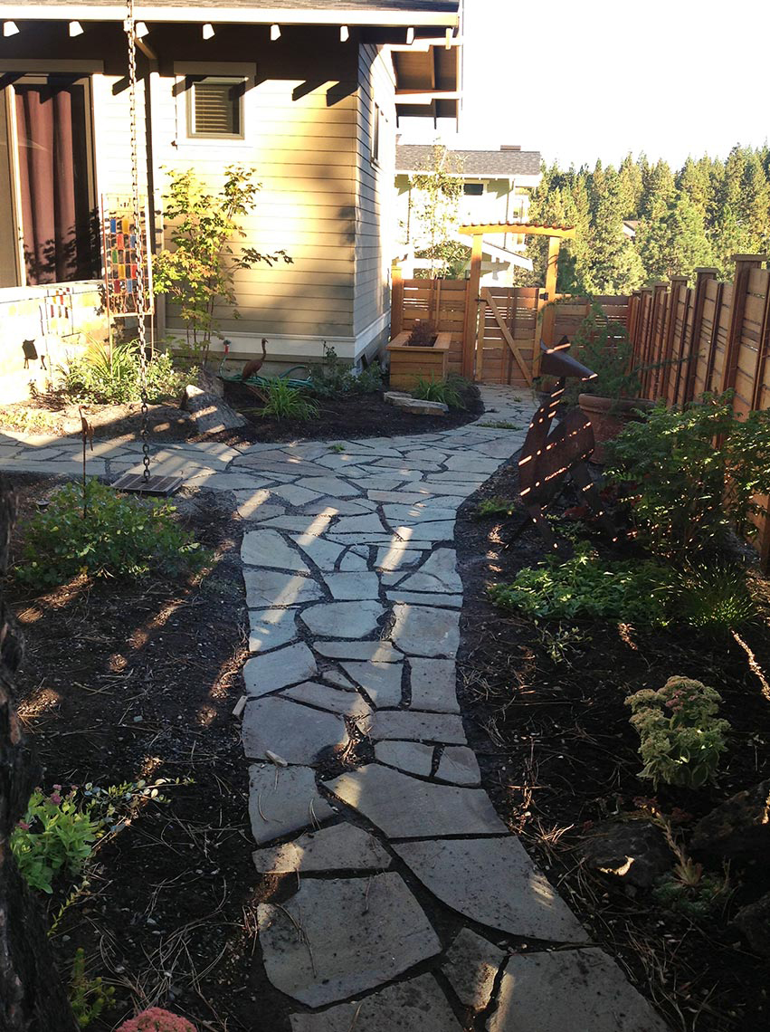 ... a dry riverbed in the sloped front entry and a stone walkway to connect  the front porch to the backyard, then filled the space with native plants. - Sticks And Stones Landscape Design