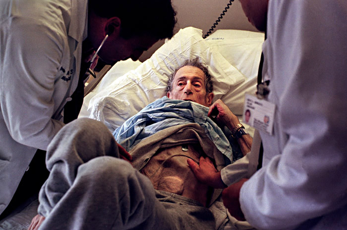 Technically too old and too thin to be on the transplant list, Saul is also too ill to go home. Here, Saul's doctors are inspecting his condition, and point out that his LVAD (an assist device for his failed heart valves) was visible beneath his skin.