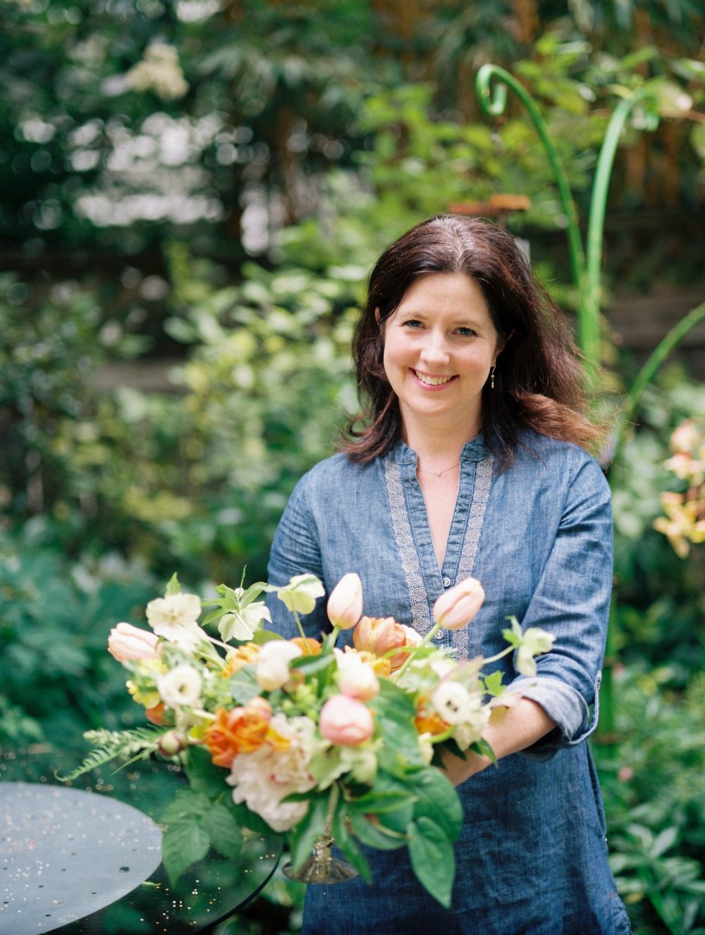 About us - Smashing Petals is a boutique floral design studio in Seattle.  We specialize in garden style arrangements for weddings and parties.  No matter how small your gathering, we would love to be part of it.Keita Horn, our founder pictured here, is a Pacific Northwest Native. She, her son and husband live in Ballard. They enjoy kayaking in stormy weather, reading books, traveling and cooking for friends.
