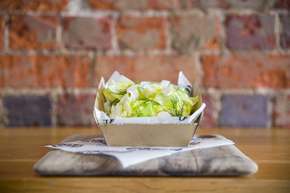 iceberg salad - Iceberg, shaved ricotta, dill, lemon vinaigrette$6