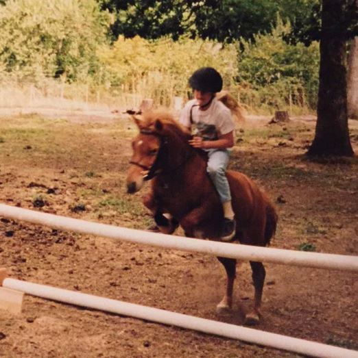Holly as a young girl on her 38 inch tall Shetland pony named Skippy jumping over a 28 inch jump!