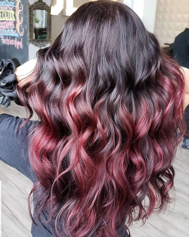 Talk about a hair journey! This guest came in wanting a complete hair makeover and this beautiful red balayage made that happen! This is hair goals❤🖤 swipe -----  to see the before! Transformation done by @katievaughan20.  @jointhehairjourney