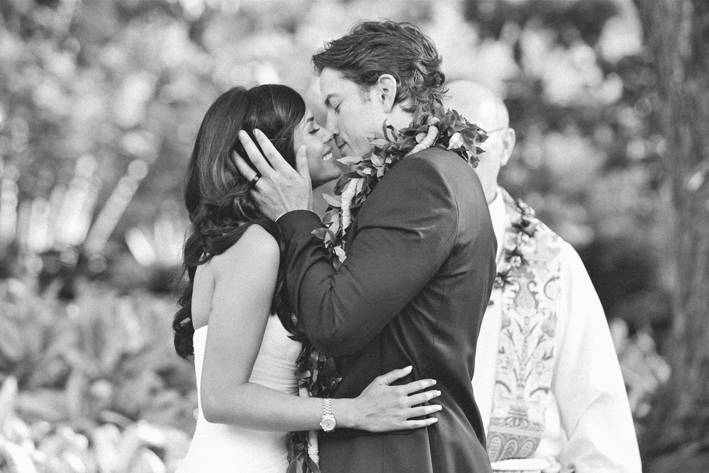 Black and White Wedding Photography Ceremony Kiss