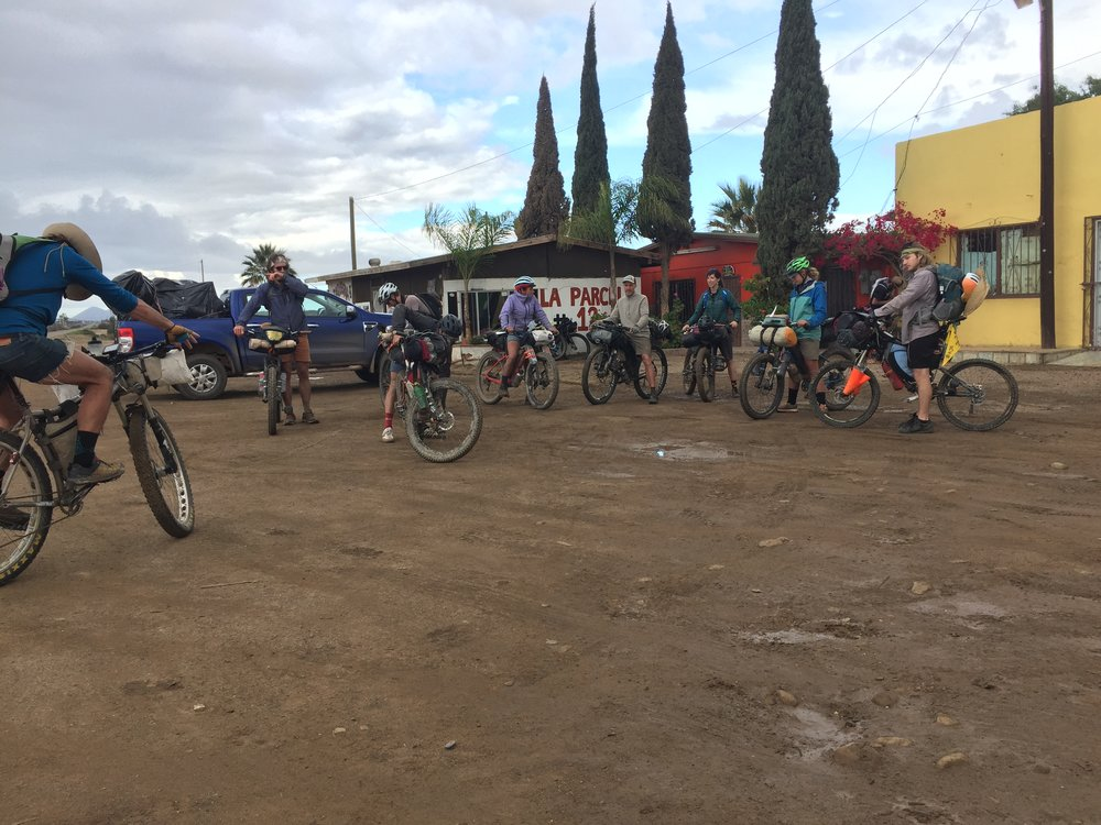 20 Baja Divide riders preparing to embark on a reroute around peanut butter mud just south of Nueva Odisea