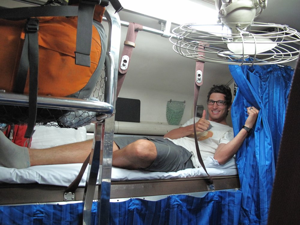 Loving life on the overnight train during our  28 hour adventure  between Laos and Myanmar