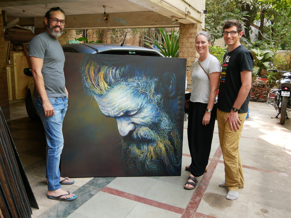 Us with Viveek and one of his paintings
