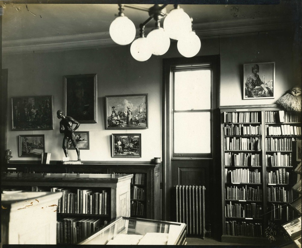 Image Courtesy of the Photographs and Prints Division, Schomburg Center for Research in Black Culture, NYPL         Writing Blackness: Harlem | Paris   is an exploration of the Harlem Renaissance through the Schomburg Center collection. This exhibit was inspired by literary salons, convening spaces where intellectual and arts movements were fostered through dialogue and the exchange of ideas among cultural producers.   The Harlem Renaissance and Négritude, as literary and ideological movements, advanced the visibility and form of black cultural and political thought. Artistic and cultural works illustrated a new understanding of blackness within the Diaspora that echoed intellectual and scholarly interrogations of race consciousness, solidarity and pride. From its origins, the Schomburg Center was at the heart of the New Negro Renaissance, and has a large repository of archival materials on Harlem and the black world from this period.   Writing Blackness aims to incite intellectual engagement by 'activating' the collection, making items accessible in a living space — literally, a 2 bedroom apartment in an affordable housing, educational and cultural arts mixed-use development. This exhibition   illustrates Arturo A. Schomburg's pivotal role in collecting materials and supporting the cultural movements of the 'new negro' that travelled between Harlem and Paris and the center's continued legacy of preserving and providing access to materials documenting the global Black experience.      Clarisse Rosaz Shariyf and Ladi'Sasha Jones, Curators