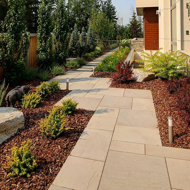 Another photo from our Saskatchewan Drive Project. @techobloc Aberdeen Slabs were a great choice here for the Dimensional Paver Pathway. Aesthetically, they struck the transitional balance we were looking for.  #yeglandscaping #jadelandscaping #yeglocal #yegphotography #yeglandscaper #yegdesign #yegcustom #yeginfill #yegconstruction #landscapedesign #landscapelighting #landscapearchitecture #landscaping #pavingstone #dimensionalpaver #pathway #patio #hardscapes #hardscaping #barberry #belgravia #inlite #techobloc #aberdeenpaver