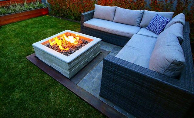 Space optimization is key in a smaller yard. We were able to create seating for 5 around a gas firepit in under 70 square feet. We started with the sectional and worked backwards from there with natural stone tiles for the patio, hardwood trim and a custom concrete firepit to round things out proportionately,  making for a compact yet comfortable entertaining space in the evening.  #jadelandscaping #yeglandscaping #yeglandacaper #yegcustom #yeginfill #yeghomes #yegbuilder #yegconstruction #yegcustomhomes #yegdesign #landscapedesign #landscapearchitecture #landscaping #naturalstone #patio #paving #firepit #gasfirepit #nightscape #lowvoltagelighting #led #in-lite #cotoneaster #autumn. * * * Now booking for Spring/Summer 2019!