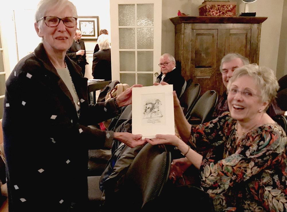 Carole Badgley, Past FANS Board member with Lynn Johnston, 2017 FANS Distinguished Artist winner. With Lynn's cartoon drawing