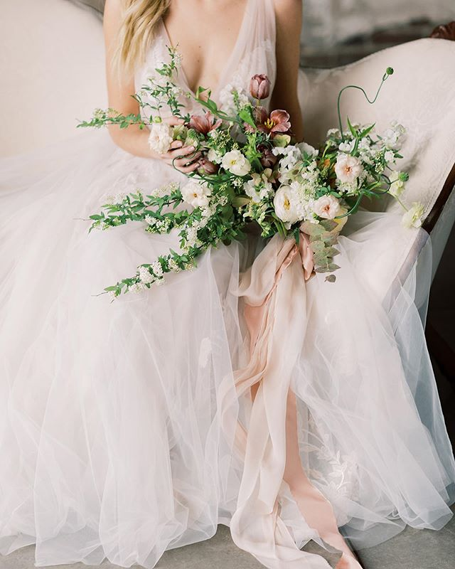 Spring bouquet by @evergreenflowerco with @froufrouchic ribbon - Photography: @laurenleephotography . . Gown: @lajeunemariee Venue: @strongwater_events  Rentals: @somethingolddayton  Styling: @the.mari.foster  Model: @paigehohman . #ffcbouquets #froufrouchic