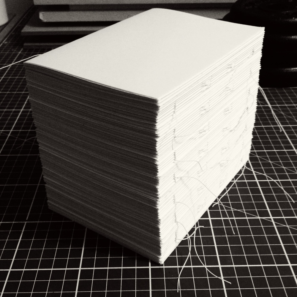 A set of textblocks sewn and ready for endpapers and linings.