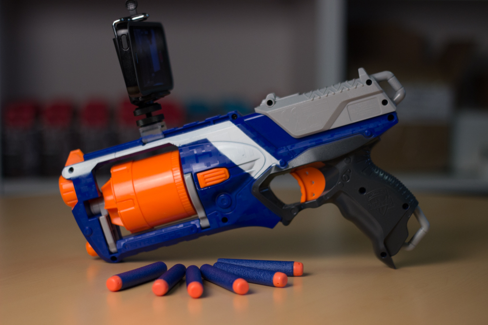 Yes, that is an iPhone mounted on a Nerf Gun via a 3D printed bracket and the Triggertrap Phonetrap.