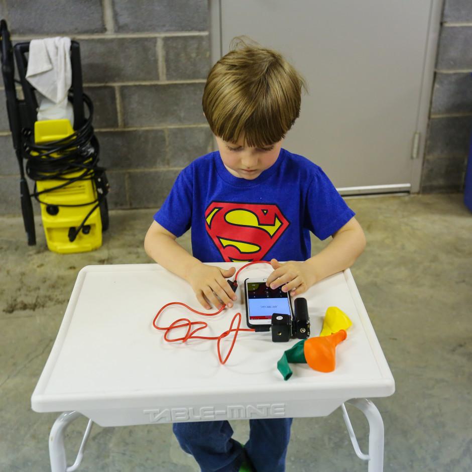 Aiden adjusting the flash delay using the Triggertrap iOS app.