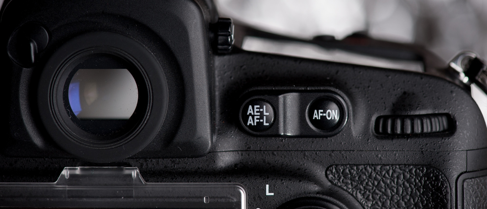 On a Nikon D810 you can assign the AF-ON button, on other cameras you'll only have the AE-L button.