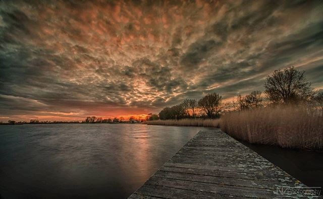 @nick_veld used our LE HDR mode to create this awesome #sunset photo in the #Netherlands. He took five pictures with a total shutter time of around two minutes and then merged them in lightroom.  We can't get enough of that moody, fiery sky!  #skyscape #photooftheday #longexposure #capture #moment #photodaily #photogram #landscape #landmark #focus #photog #travel #explore #adventure #art #picoftheday #photography #camera #lens #potd