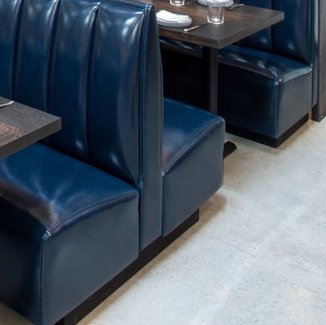 The first of six images to start the refresh of our feed! Classic high-gloss vertical-tufted booths with 'kiss-burnt' tabletops by @delta_millworks.  Make sure you head over to our latest #eastaustin restaurant!  photos by Reagan Taylor . . . #whosyourarchitect #designhoundatx #architecture #architecturelovers #residentialdesign #interiordesign #commercialdesign #hospitalitydesign #restaurantdesign #austintx #atx #designinspiration #architecture_hunter #designboom #archdaily #architizer #dezeen #dwellmagazine #wepostourwork #simplemoderncomfortable #comingsoon