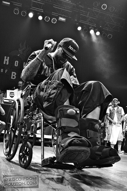 Slim Thug holdin it down in a wheelchair.