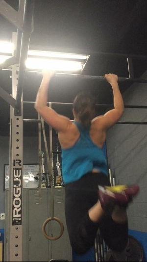 Ashley, practicing her butterfly pull-ups.