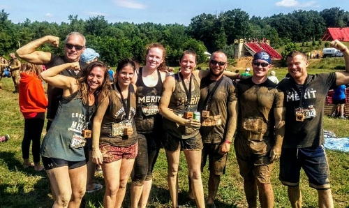 Stephanie and other Merit members after finishing the Warrior Dash 2017.
