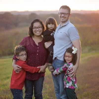 Grace, her husband Ryan, and their three children.