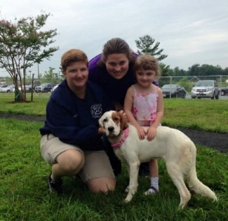 Katie, her wife, her step daughter and one of their many family pets!