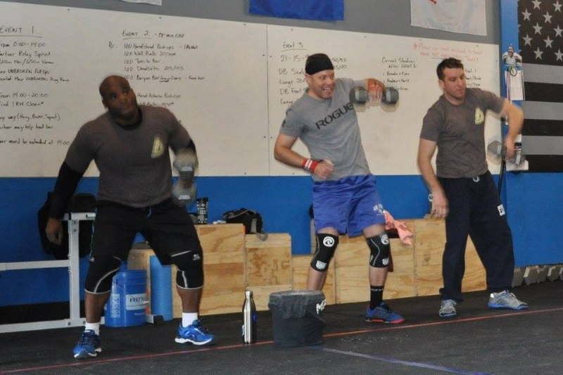 Mark performing dumbbell snatches during the Merit Winter Classic.